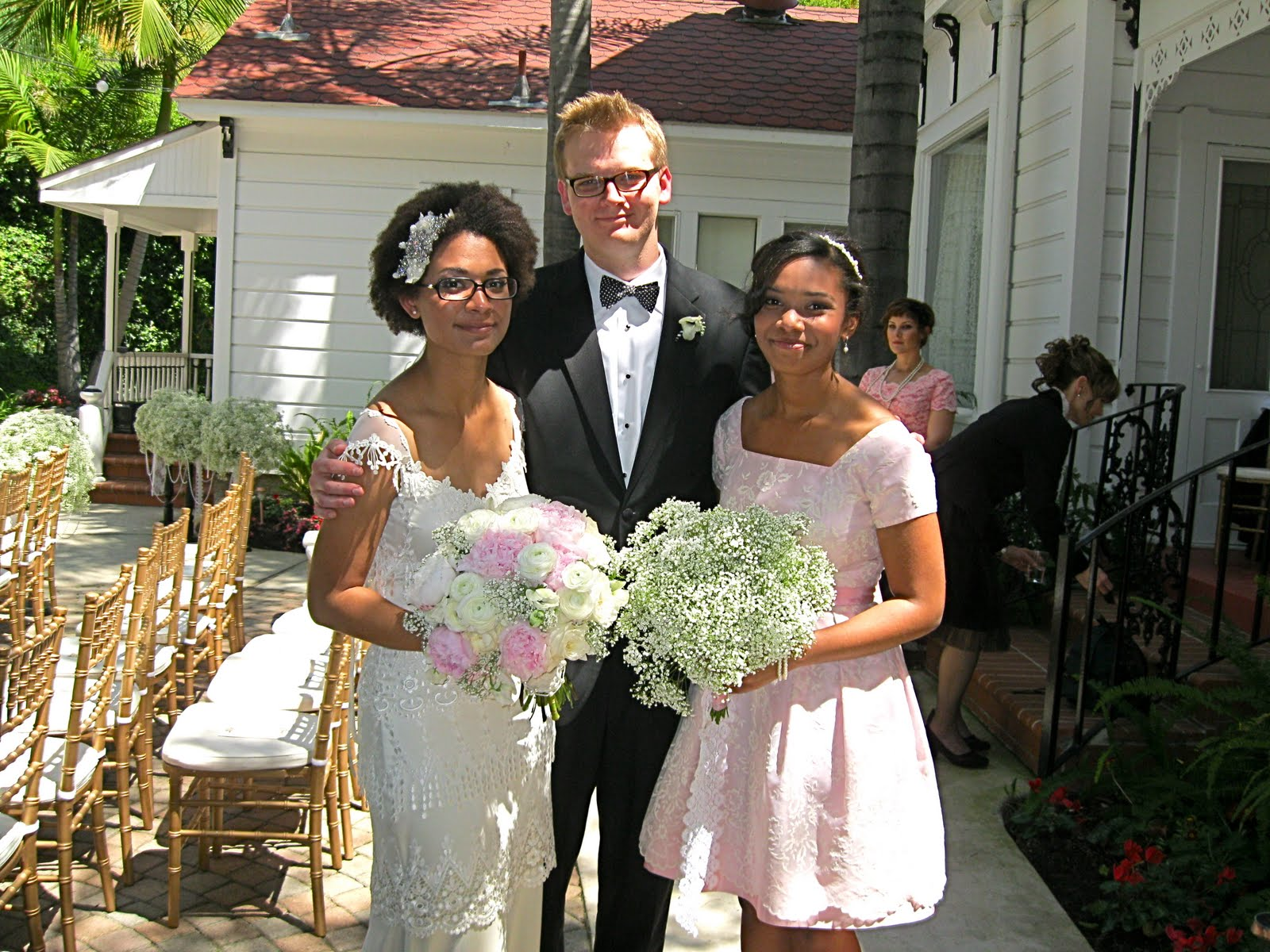 7f832e42a021 For their wedding, we lined the aisle with big, giant, fluffy puffs of Baby's  Breath on black stands. We strung pearls through and around them and added  a ...