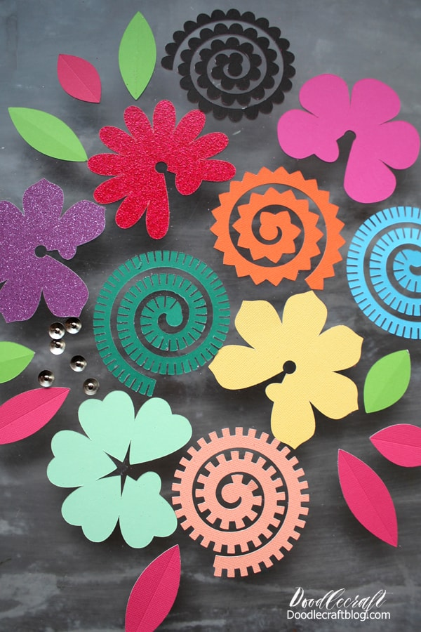 Colored paper cut outs to form into 3D flowers