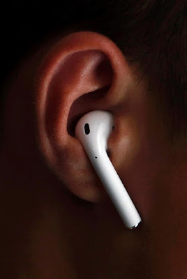 An_attendee_wears_the_Apple_AirPods