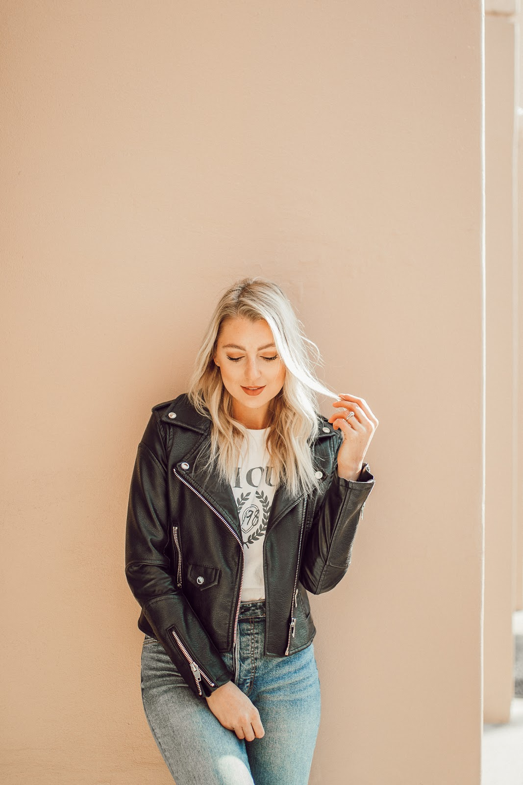 leather jacket over a graphic tee