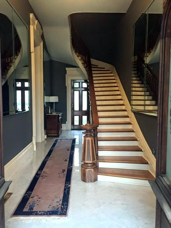 Foyer With Curved Staircase And Marble In Historic Home Indiana