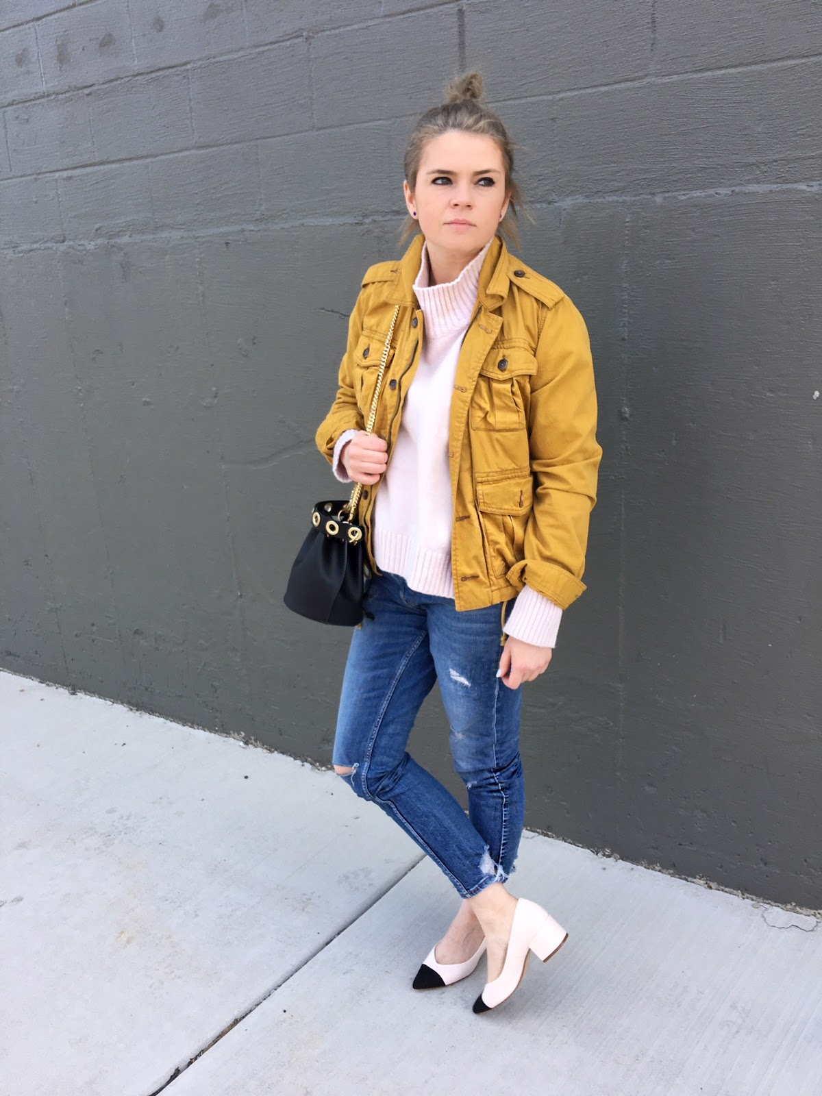 Mustard yellow jacket and black cap toe shoes