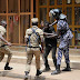 Ugandan security forces attack and detain journalists covering protests