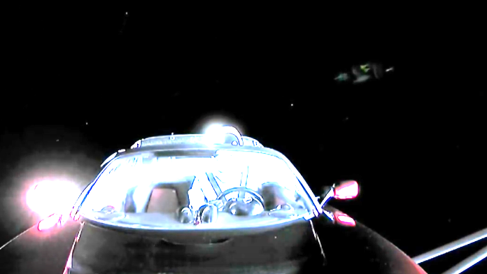 tesla car in space live. large ufo shows up on live cam during spacex tesla car orbit, feb 6, 2018, sighting news. in space