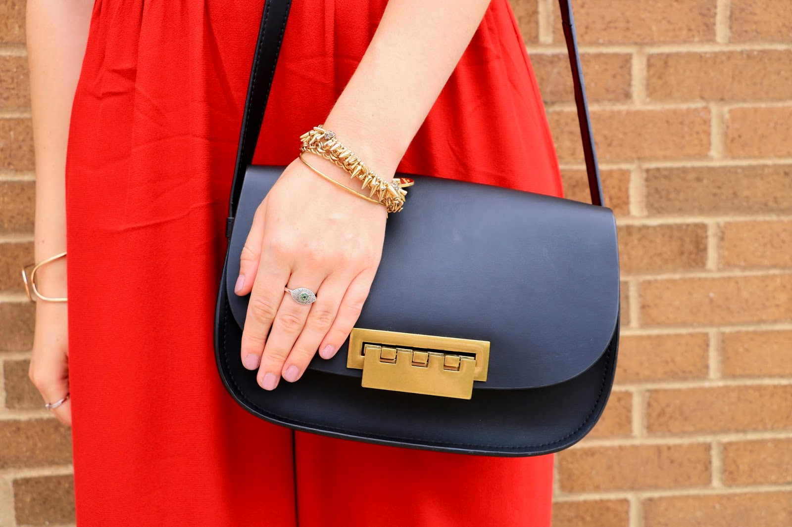 Fashion blogger Kathleen Harper wearing black zac posen bag