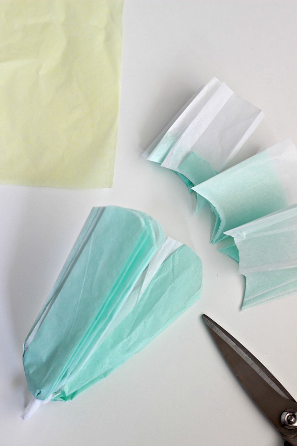 How to make tissue paper flowers 2 ways dimples and tangles cutting the ends into a point also gives a nice look to the finished flower so you can choose what shape you like best or mix them together mightylinksfo