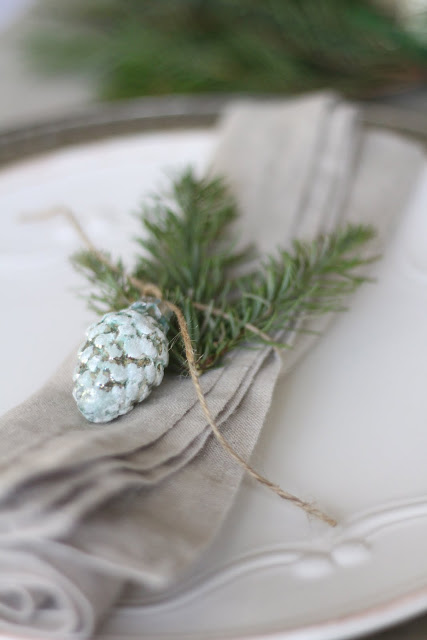 holiday tablescape greens linen napkins white and greens