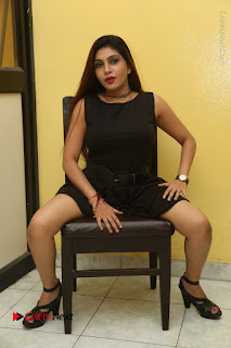 Tollywood Upcoming Actress Pooja Roshan Stills in Black Short Dress at Plus 1 Movie Trailer Launch  0303.JPG
