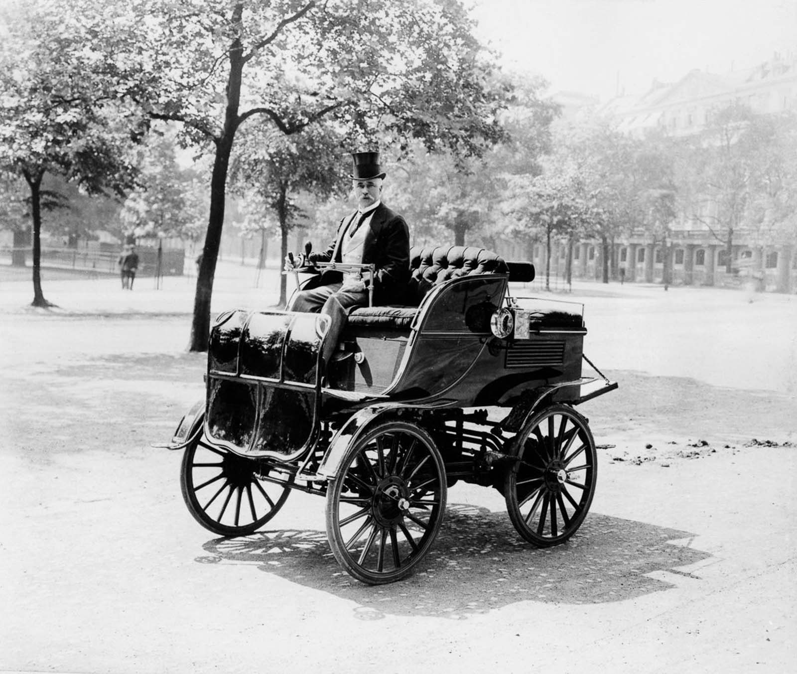 Roger Wallace drives his electric car. 1899.