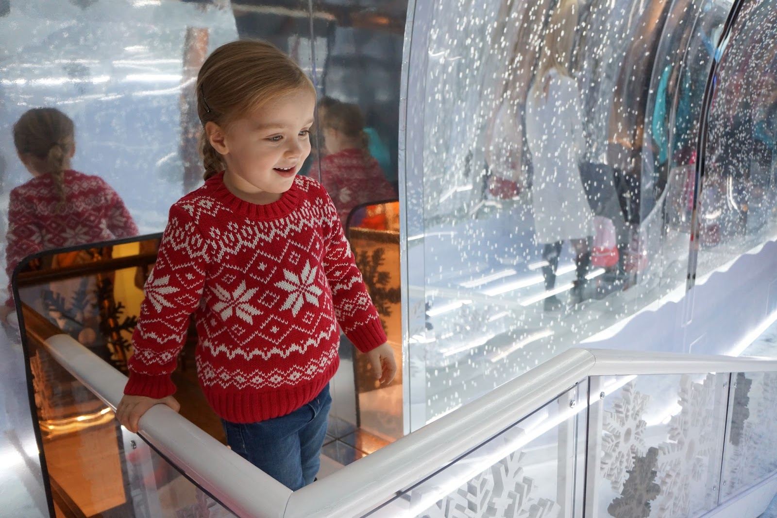 young girl in polarn o pyret red white christmas jumper