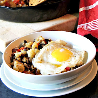 This Cauliflower Hash recipe is a delicious, low calorie, gluten-free, vegetarian or vegan, way to have that standard breakfast hash with zero guilt. #breakfast #cauliflower #potato #breakfast #glutenfree #vegetarian #vegan #recipe | bobbiskozykitchen.com