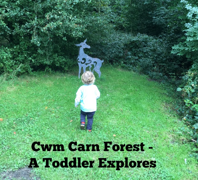 Cwm-Carn-forest-A-Toddler-Explores-text-on-image-of-toddler-and-metal-cutout-of-a-dear