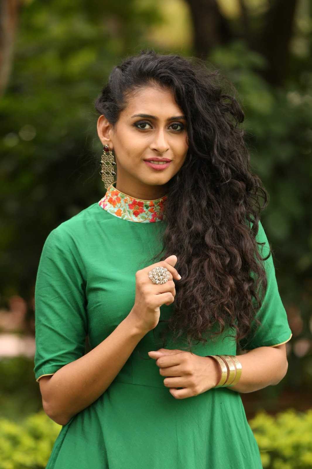 Nithya Naresh Curly Hair Cute Face Looking Stunning In Green Dress At Reverence Art Showcase August 2018