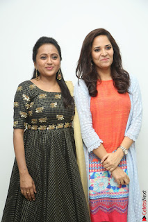 Actress Suma in Black Salwar Suit and Anusuya in orange Dress at winner movie press meet part 1 February 2017 (46).JPG