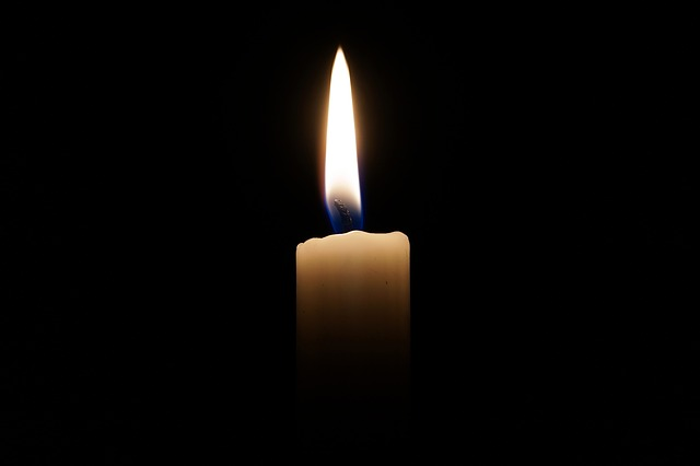 single candle against the darkness