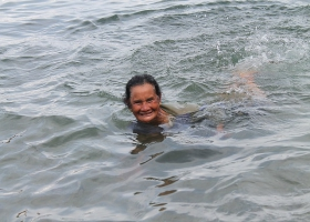 A old woman enjoying a swim.