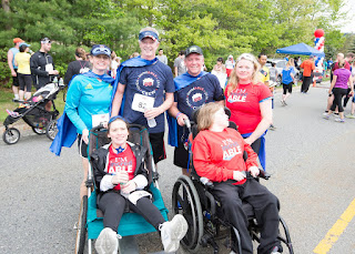 Michael Moloney, CEO of HMEA, and Massachusetts Representative Jeff Roy, were all smiles at the finish line of HMEA's incredABLE Walk, Run and All-Day Family Fun at EMC2 in Franklin, MA, on May 22