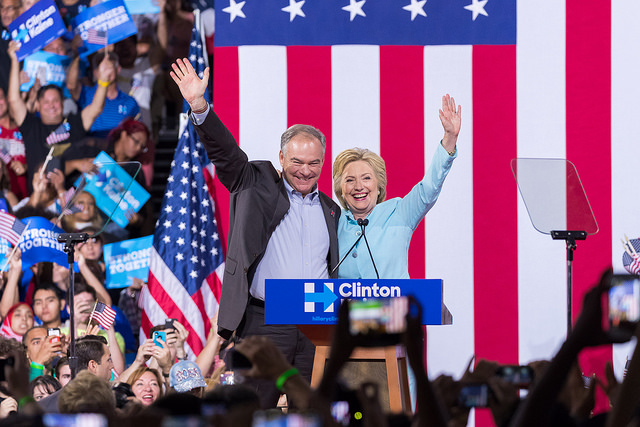image of Tim Kaine and Hillary Clinton onstage at a rally together, smiling