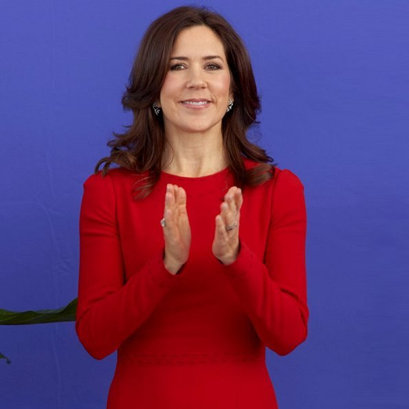 Crown Princess Mary wore a red midi dress by Dolce and Gabbana. Crown Princess Mary Dolce & Gabbana red contrast-stitch cady dress