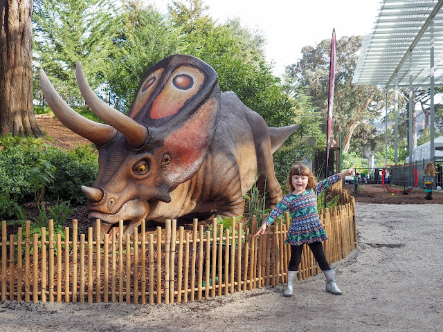 girl and torosaurus dinosaur