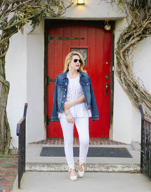 all white outfit with jean jacket and soludos espadrilles with lisi lerch earrings