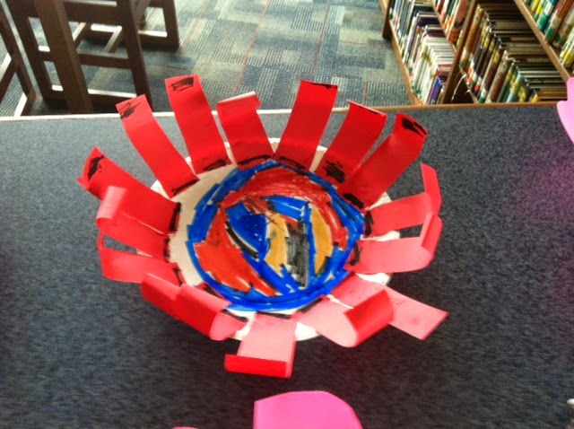 second grade made dot flowers for Dot Day in the library collaboration project