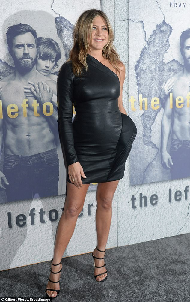Jennifer Aniston Steps Out In Braless Skintight black Leather Mini Dress