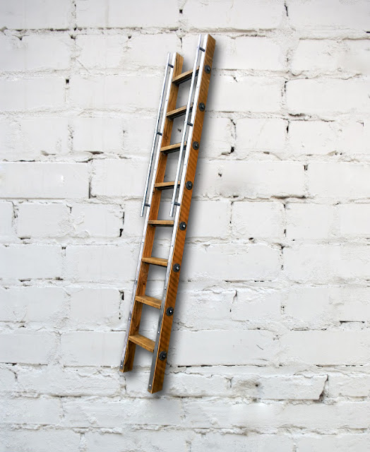 Reclaimed wood library or loft ladder for a Vancouver shop.