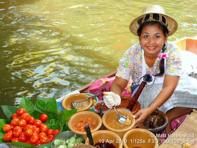 people, street portrait, high-angle shot, Thailand, Bangkok, Taling Chan Floating Market, floating market, Thai food, som tum, green papaya salad, delicious, boat vendor