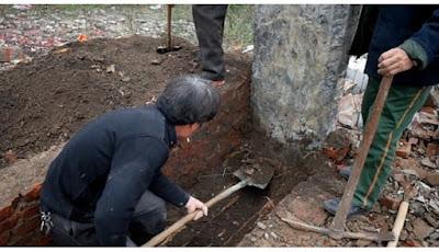 budaya menggali makam di china