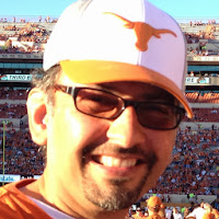 Sanjay Dalal wearing Glasses and Longhorn Hat - Headshot November 2, 2013