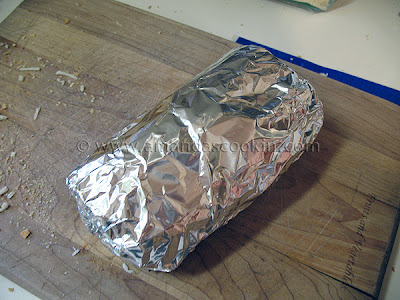 A photo of a grinder sandwich wrapped in foil.