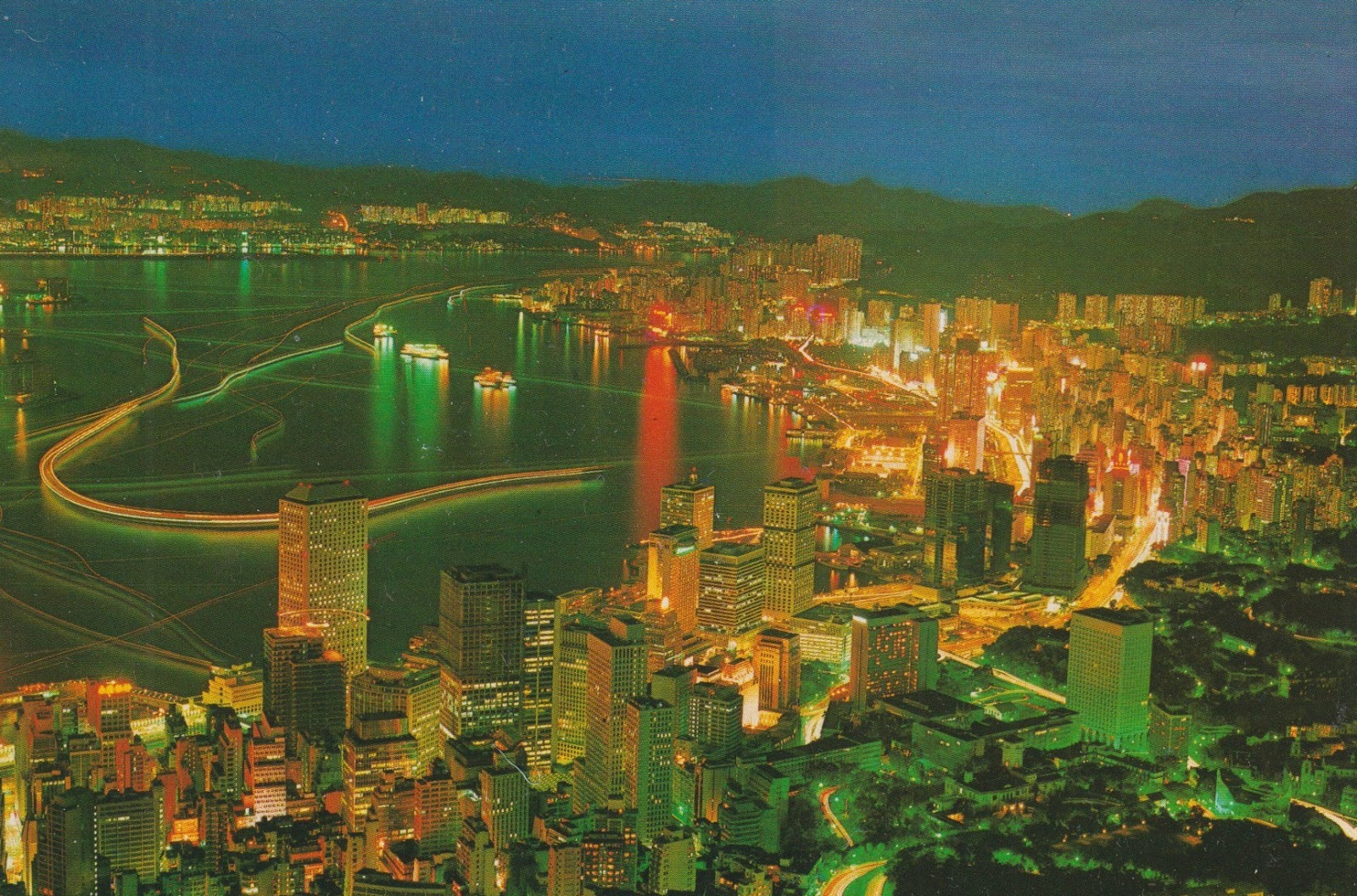 these hong kong postcards remind me of new years fireworks with all their bright lights and colors