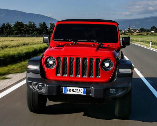 Jeep Wrangler Climbs Red