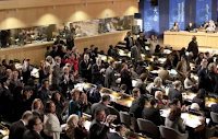 Delegates cheer after they approved the membership of Palestine during Monday's session of UNESCO's 36th General Conference in Paris.