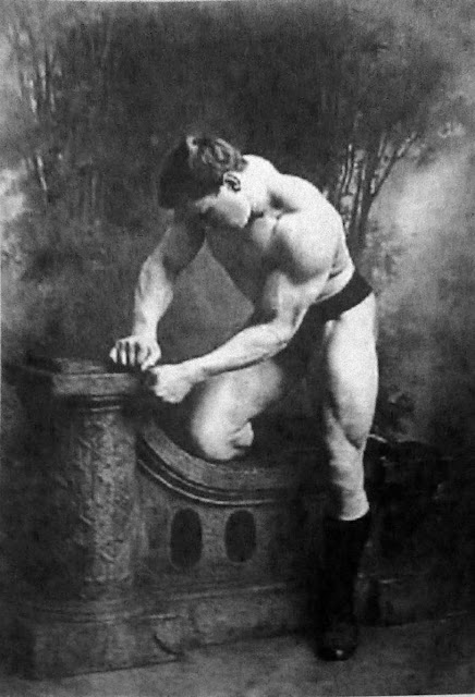 George Hackenschmidt, circa 1900. He is believed to be the creator of the professional wrestling version of the bear hug as well as the person who popularised the hack squat, a deadlift with arms behind the body.