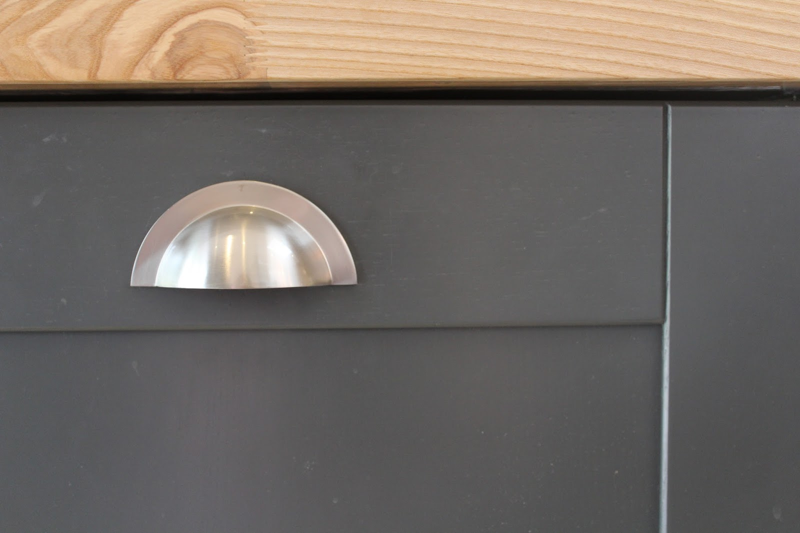 Satin Drawer Pull in Dark Kitchen