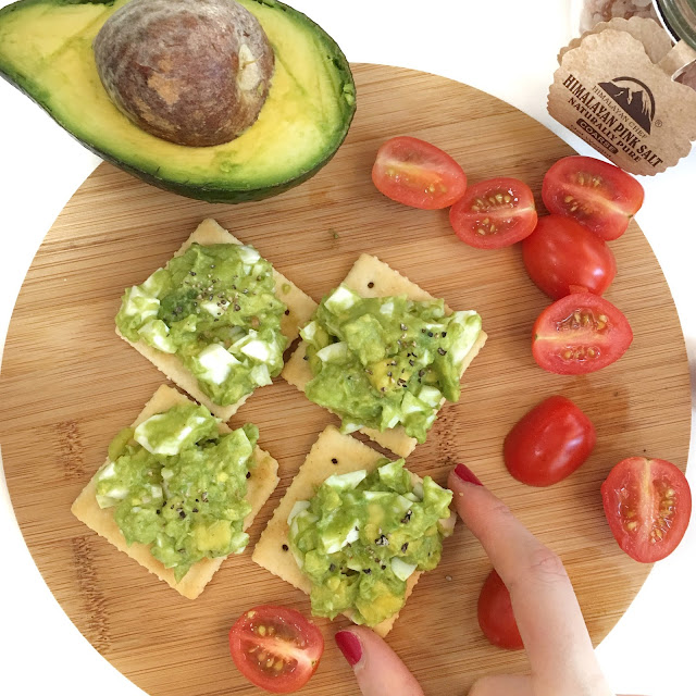 Serving Avocado Egg Mash on Crackers