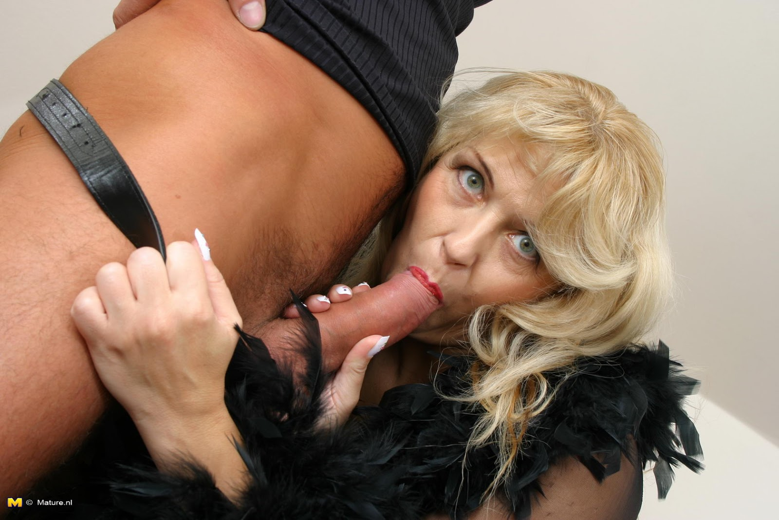 Amateur blonde loves sucking black cock 9
