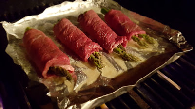 The Asparagus stuffed rouladen sizzling away on the bbq
