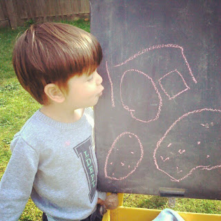 Child with a drawing of a tractor on Instagram
