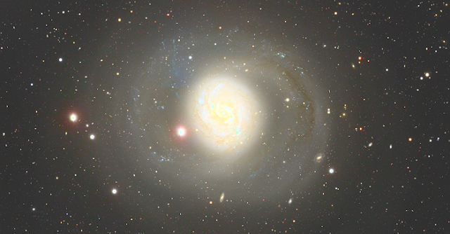 The deep image of Messier 77 taken with the Hyper Suprime-Cam (HSC) mounted at the Subaru Telescope. The picture is created by adding the color information from the Sloan Digital Sky Survey to the monochromatic image acquired by the HSC. (Credit: NAOJ/SDSS/David Hogg/Michael Blanton. Image Processing: Ichi Tanaka)