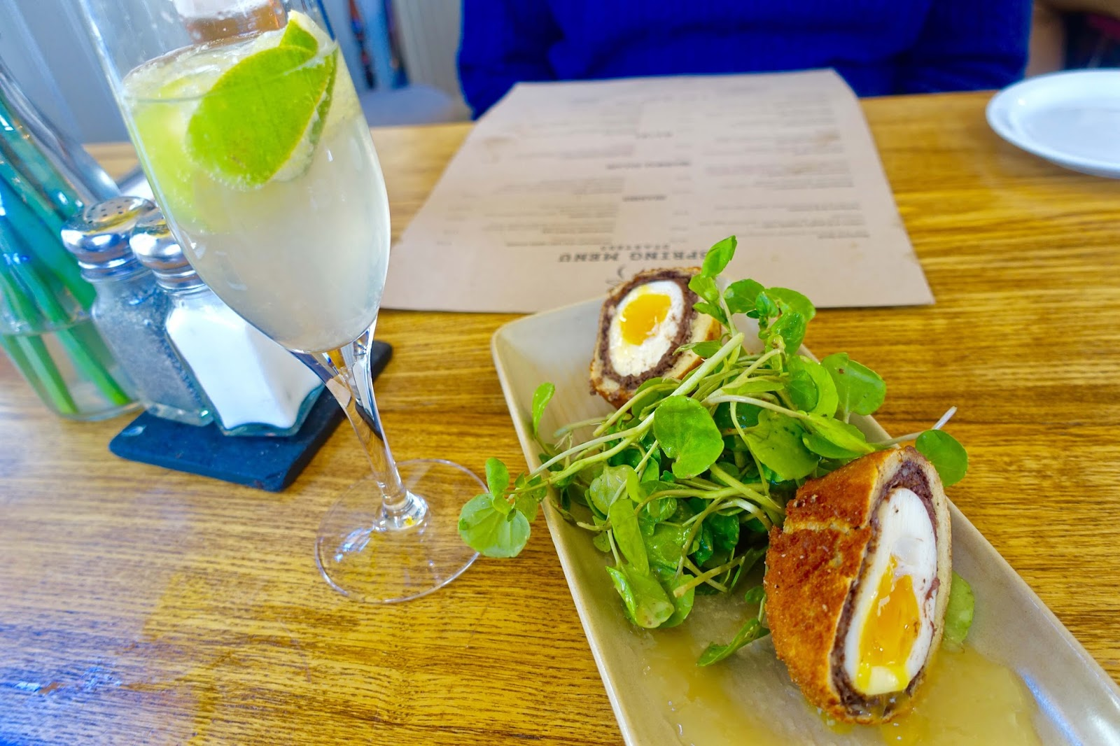 pork and black pudding scotch egg with cress and apple sauce