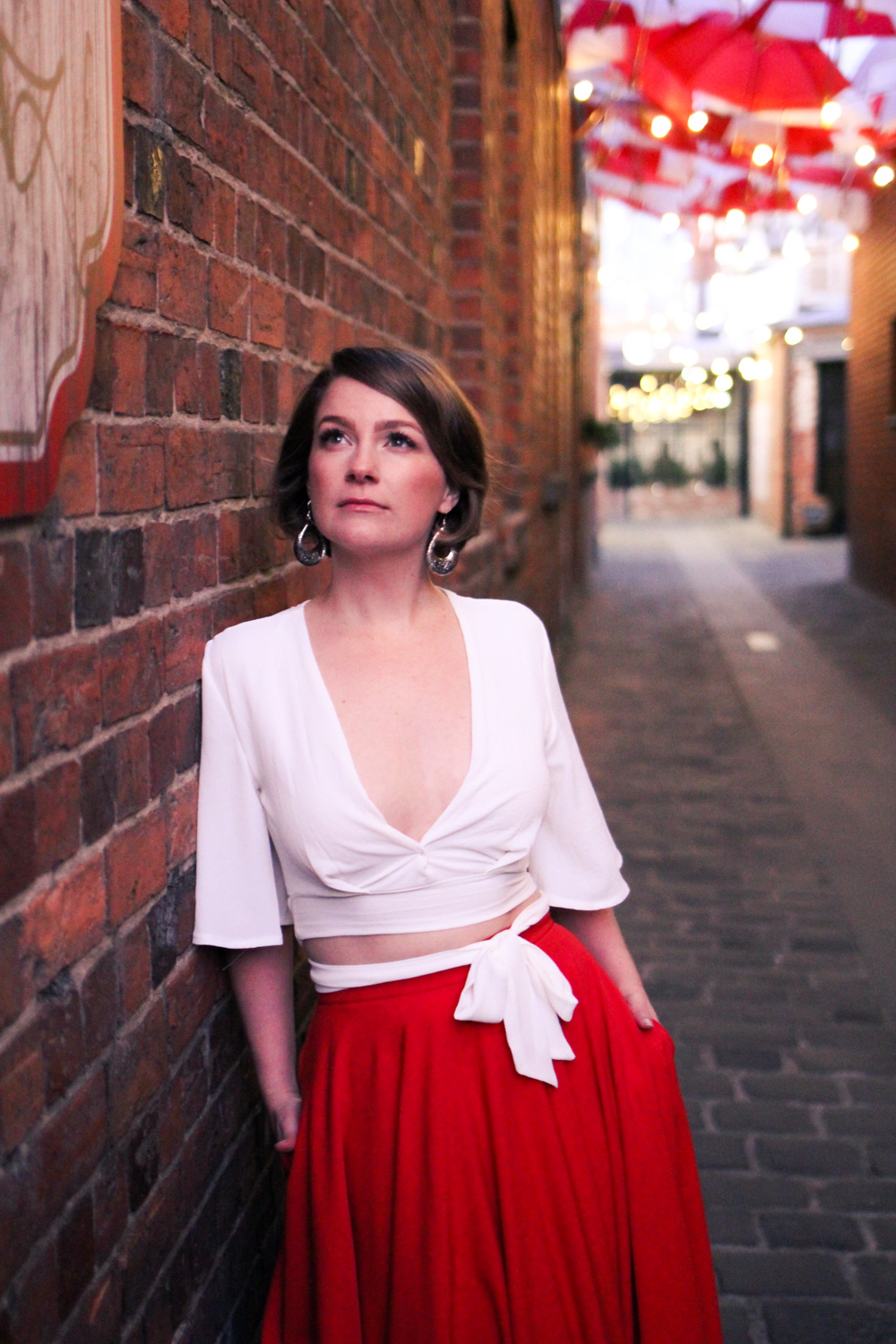 @findingfemme wears red maxi circle skirt from Mokkafiveoclock and white top at Hop Temple in Ballarat.
