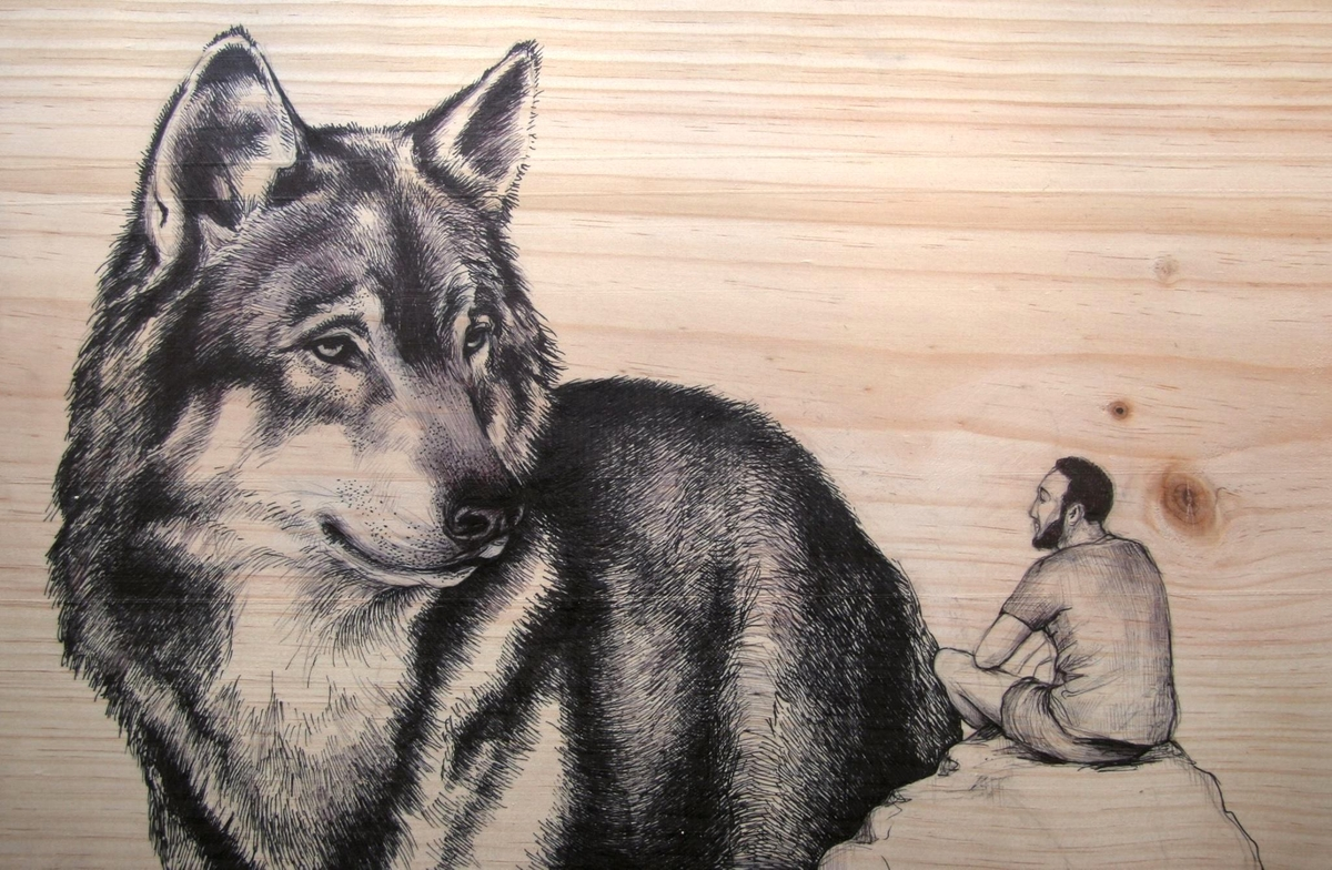 06-Wolf-and-man-00-Martina-Billi-Recycled-Wooden-Planks-Used-to-Draw-Animals-www-designstack-co