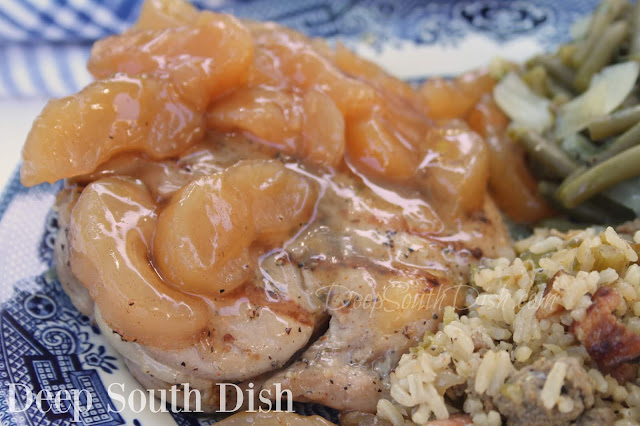 Thick-cut brined and seasoned pork loin chops, topped with skillet fried apples, or a homemade or canned apple pie filling, and baked in the oven.