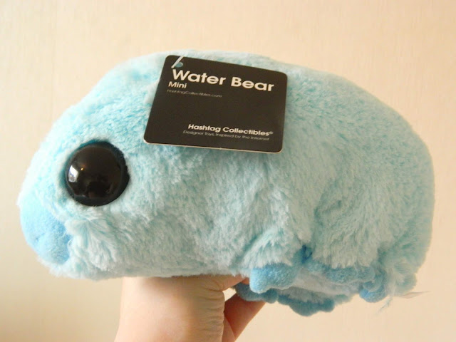 A blue plush toy of a water bear from Firebox