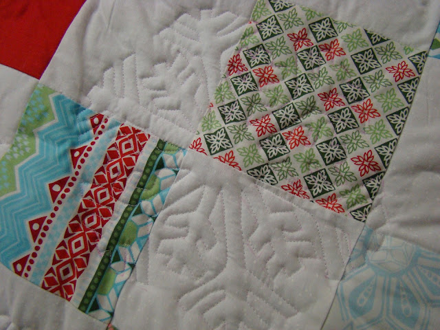 On point charm square Christmas quilt with Kate Spain Flurry fabric