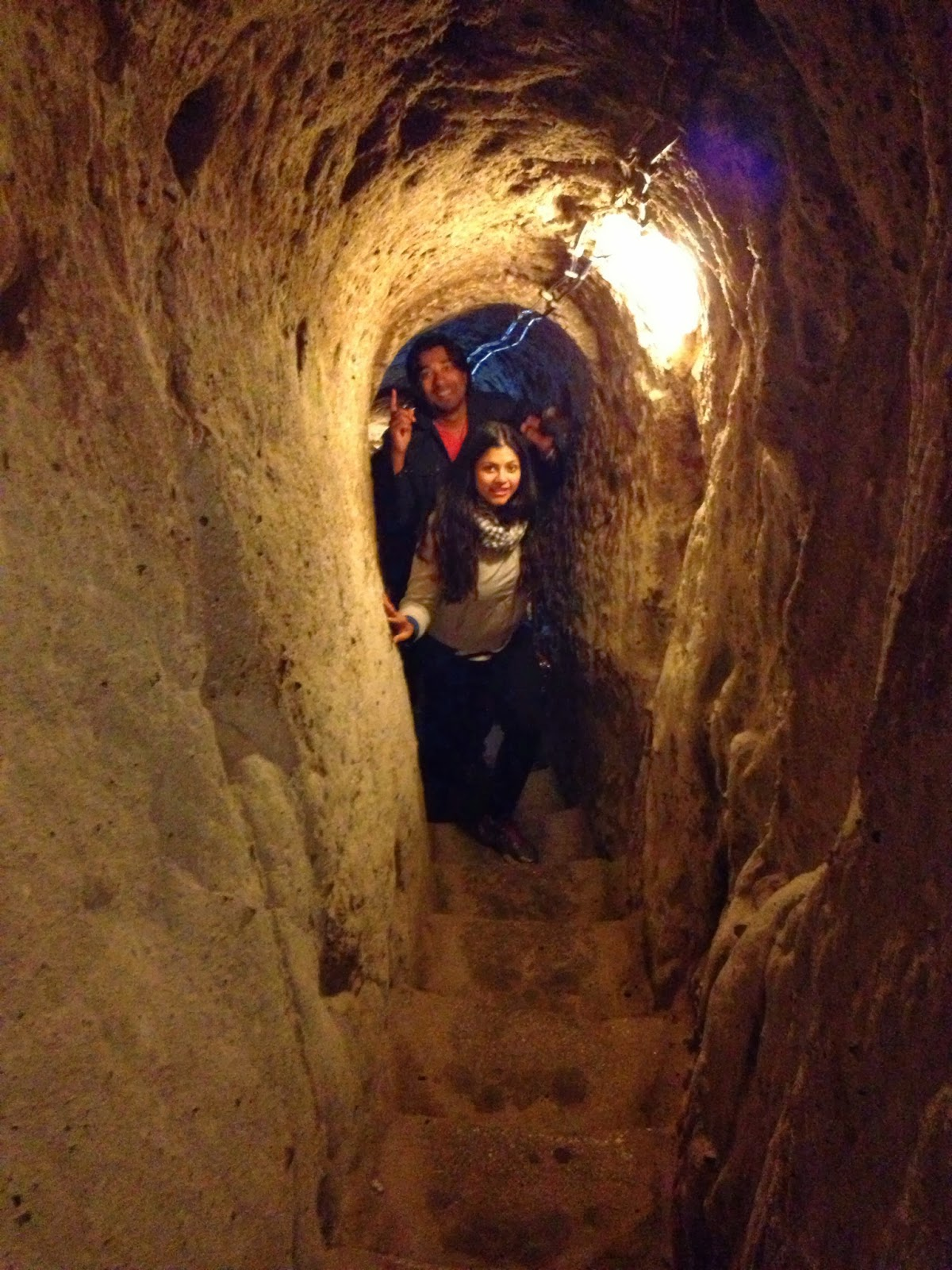 Cappadocia - Trisha and Abhi make their way up an underground narrow stairway