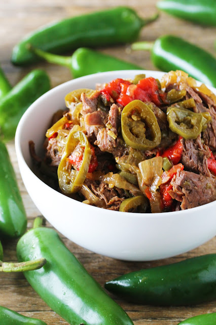Tender and flavorful shredded beef with peppers and onions, all cooked low and slow in the crockpot.